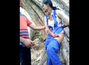 Indian young woman duo plowing in jungle