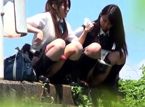 Asian maidens urinate arcs outdoors